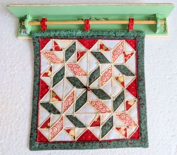 "Quilt (Red & Green) displayed on Wall Rack 1"" Scale"