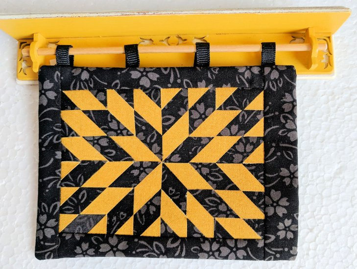 "Black and Gold Quilt displayed on Wall Rack w/ Shelf 1"" Scale - Click Image to Close"